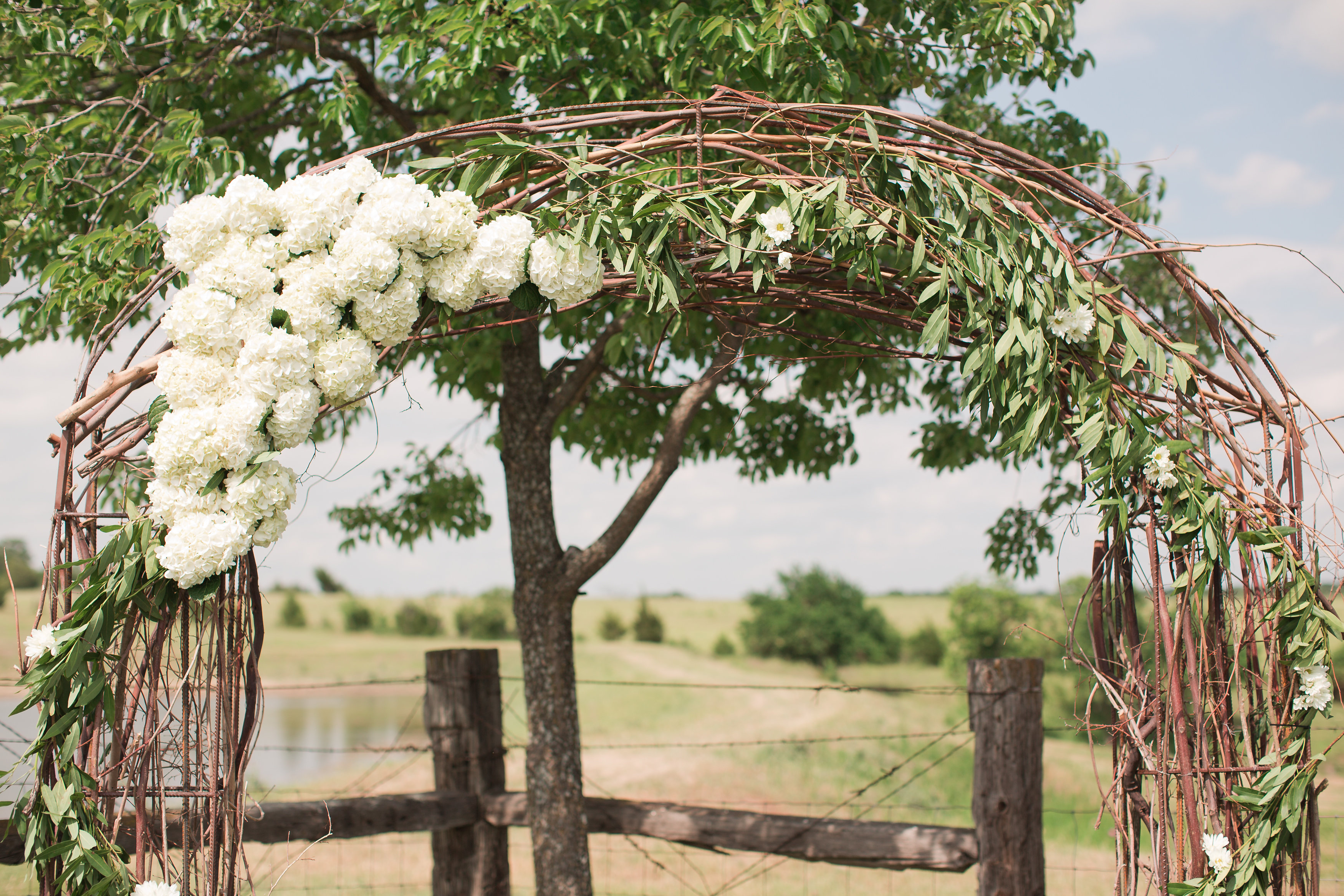 Simple arch decoration with hydrangeas, vines and greenery
